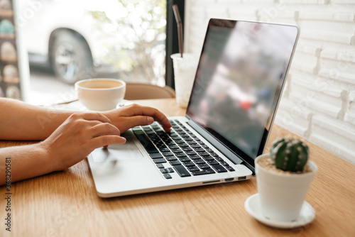 Photo laptop and female hands use a keyboard while typing and surfing the internet