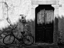 Bicycle Parked By Old House