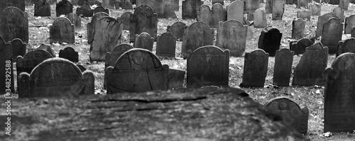 Fotografiet Tombstones In Graveyard