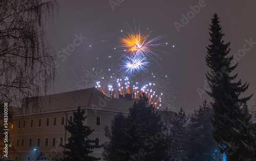Multi-colored fireworks of the new year eve in Banska Bystrica. #348300508