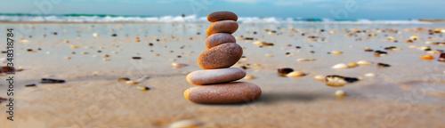 Fotografie, Obraz stones stacked on the beach