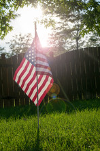 American Flag On Grassy Field During Sunny Day