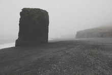 Rock Formation On Beach In Foggy Weather