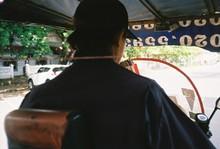 Rear View Of Diver Riding Pedicab