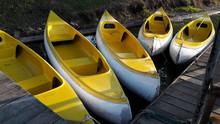 High Angle View Of Yellow Kayaks Moored At Harbor
