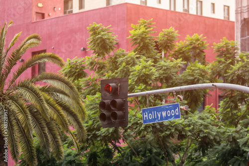 Leinwand Poster Hollywood Boulevard street sign, urban buildings and trees in Hollywood, Los Angeles, California