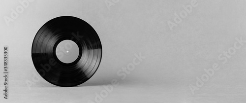 Black LP vinyl record isolated on abstract gray background with wide copy space Canvas Print