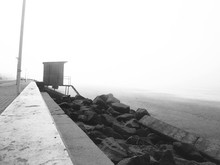 View Of Rocks On Beach Shore During Foggy Weather