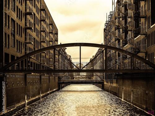 Footbridge Over Canal Along Buildings Fototapet