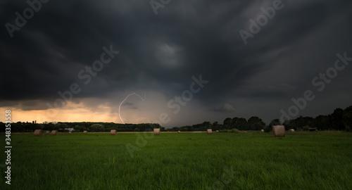 Obraz na plátně Grassy Landscape Against Cloudy Sky Stormy Weather