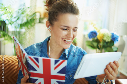 Fototapeta happy woman with tablet PC and notebook learn obraz
