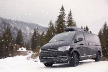 Black Car On Snowy Road. Winte...