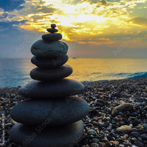 Slika na platnu Stone Stack At Beach Against Sky During Sunset