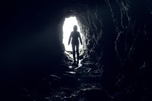 Silhouette Woman Standing In Cave