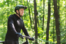Young Man Cyclist Enjoying Rid...