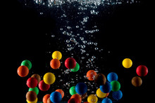 Colored Balls Falling Into The...