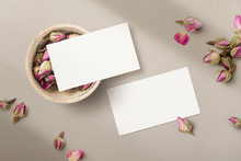 Romantic Feminine Floral Business Card Mockup / Template With Wooden Bowl And Dry Pink Rosebuds And Petals - Flat Lay / Top View - Ideal For Wedding Business Branding Or Other Feminine Designs