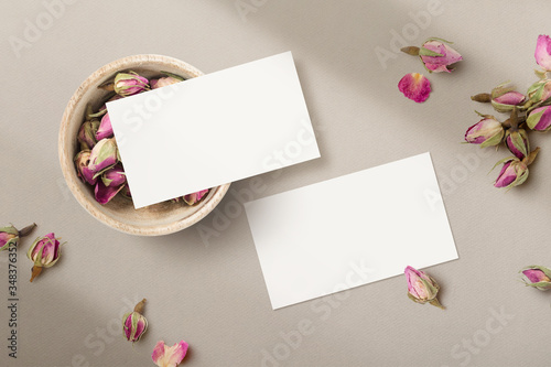Photo romantic feminine floral business card mockup / template with wooden bowl and dr