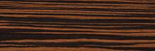 Natural Ebony Veneer Background In Elegant Brown Colors. Natural Wood Texture, Pattern Of A Long Veneer Sheet, Plank.