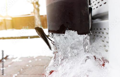 Vászonkép Frozen drainpipe of the house