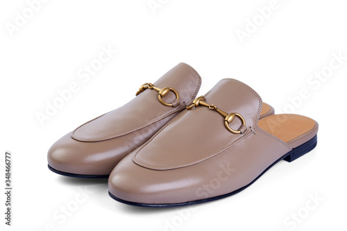 Men's lightweight home shoes in thin beige leather with elegant metal buckle without backrests insulated on white background with shadow Canvas Print