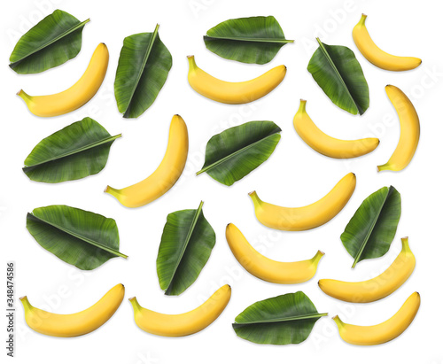 Fototapeta Pattern of bananas and leaves on white background obraz