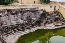 High Angle Shot Of A Stepwell Made For Storage Of Water During Old Times -Rain Water Harvesting Concept.