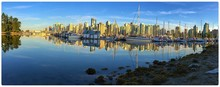 Panoramic Shot Of Sailboats Moored On Calm River In City Against Sky