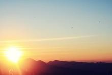 Silhouette Of Mountain Range At Sunrise