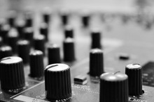 Close-up Of Knobs On Sound Mixer At Studio
