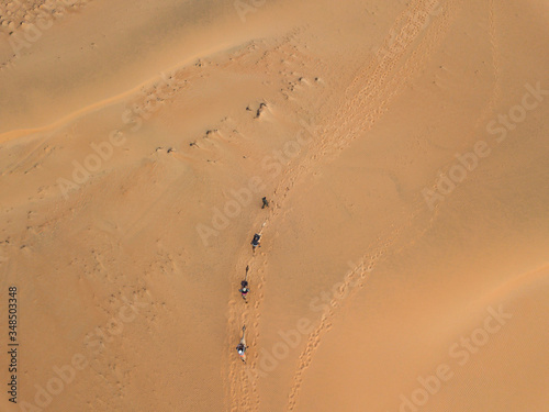 lompoul desert yellow sand photographed from the air in Africa camels and driver Slika na platnu