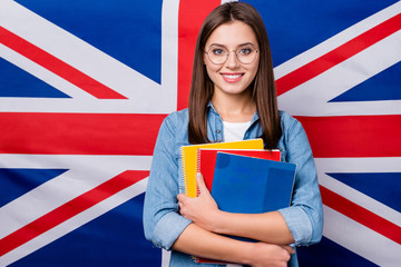 Close-up portrait of her she nice attractive smart clever cheerful cheery girl holding in hands exercise book lesson classes courses isolated over british stripes flag background