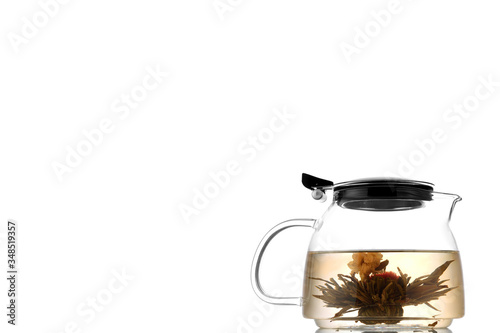 Green Chinese tea flower bud blooming in glass teapot Copy space for the ads Fototapeta