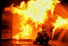 Firefighter Against Fire At Night