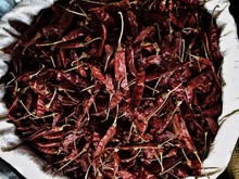 Directly Above View Of Dried Red Chili Peppers In Sack