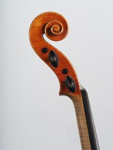 Details Of Head And Scroll Of An Antique Classical Hand Made Violin Made In Cremona Italy.