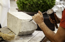 Man Carving Stone