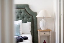 Modern Lamp On A Night Table Next To Bed, Modern Pillows In A Stylish Interior