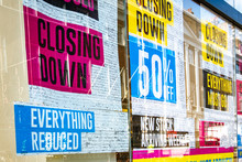 Retail Store Closing Down 'reduced, Everything Must Go' Signs In Shop Window