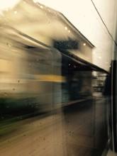 View Of Platform Seen Through Train Window On Rainy Day