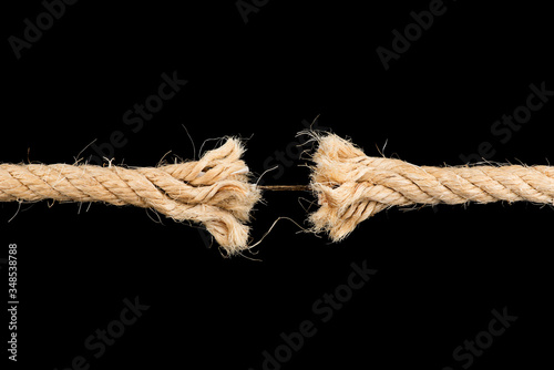 Fotomural Frayed rope sting break torn isolated on black backgroud stress weakness concept