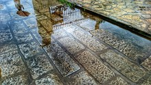 Reflection Of Gate On Puddle