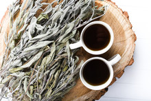 Dried Sage Branches, Sage Hot Tea, On A Piece Of Natural Wood, Natural Remedies, Natural Medicine