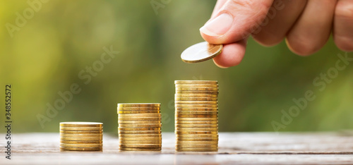 Fototapeta Growing gold money coins and hand, financial services concept, web banner with copy space obraz