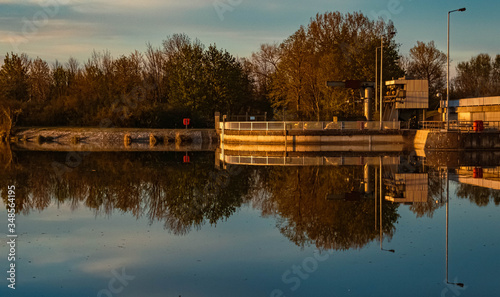 Beautiful sunset with reflections at the barrage Ettling, Isar, Bavaria, Germany Canvas Print