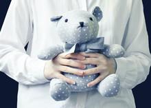 Cute Bear Toy In Hands.