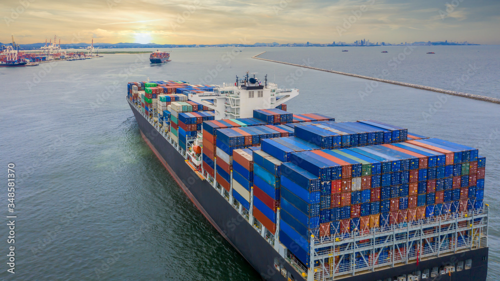 Fototapeta Container cargo ship, Freight shipping maritime vessel, Global business import export commerce trade logistic and transportation oversea worldwide by container cargo ship boat in the open sea.