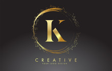K Golden Letter Logo With Golden Sparkling Rings And Dust Glitter On A Black Background. Luxury Decorative Shiny Vector Illustration.