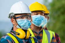Workers Wear Protective Face Masks For Safety Working At Solar Power Station,Coronavirus Has Turned Into A Global Emergency.