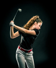 Girl Looking For The Perfect Golf Shot Isolated On Black Background